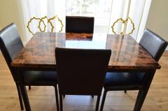 A dining table with 4 chairs